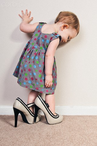 Baby Girl trying on Mother's High Heels